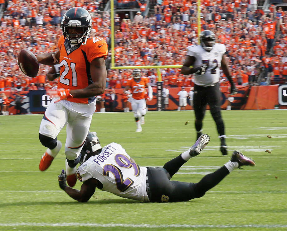 Denver Broncos cornerback Aqib Talib, left, scores past Baltimore Ravens running back Justin Forsett during the second half of an NFL football game Sunday, Sept. 13, 2015, in Denver. (AP Photo/Jack Dempsey) ORG XMIT: COCC116 Photo: Jack Dempsey / Jack Dempsey