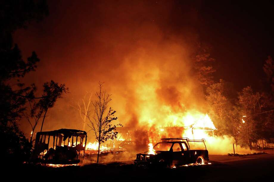 MIDDLETOWN, CA - SEPTEMBER 13: A car burns in front of a burning home during Valley Fire on September 13, 2015 in Middletown, California. The fast-moving fire has consumed 40,000 acres and is currently zero percent contained. (Photo by Stephen Lam/ Getty Images) ORG XMIT: 578028263 Photo: Stephen Lam / 2015 Getty Images