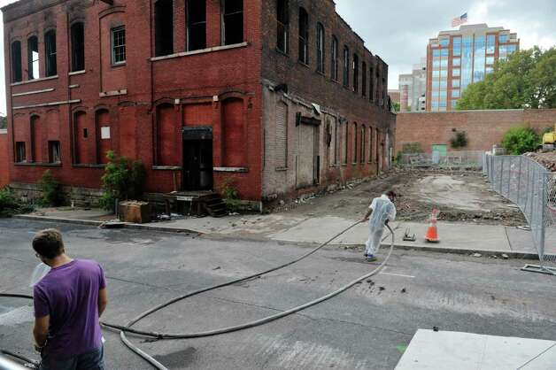 Demolition crews ready the site before knocking down the building at 32 Spencer St. on Sunday, Sept. 13, 2015, in Albany, N.Y.  The building was damaged by fire on Saturday.  (Paul Buckowski / Times Union) Photo: PAUL BUCKOWSKI / 00033339A