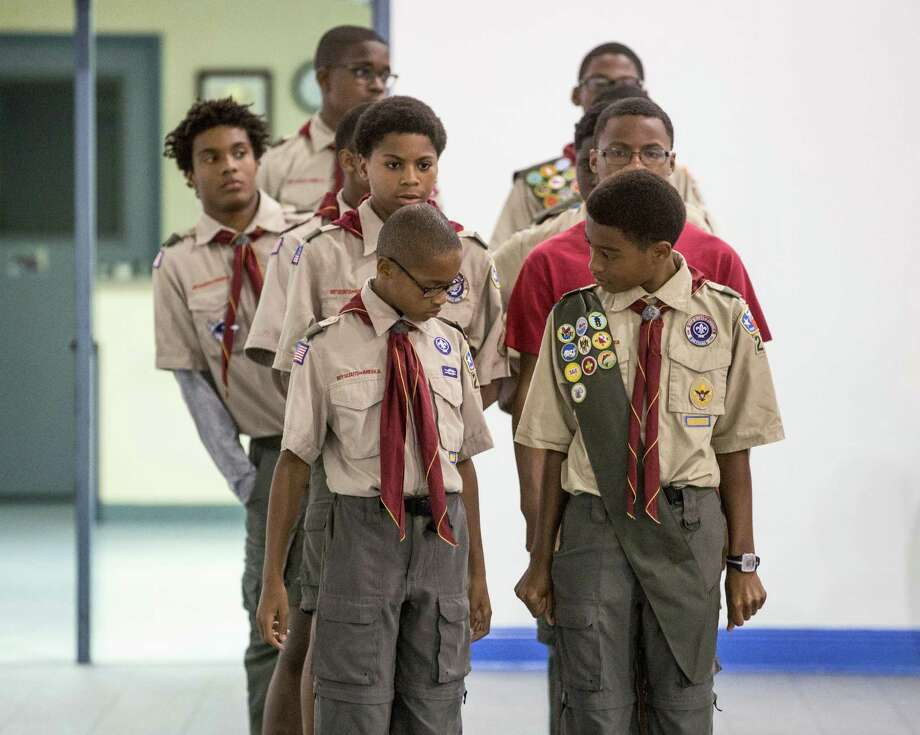 Boy Scouts with Troop 242 rehearse for a ceremony at Wheeler Avenue Baptist Church.  Photo: Jon Shapley, Staff / © 2015 Houston Chronicle