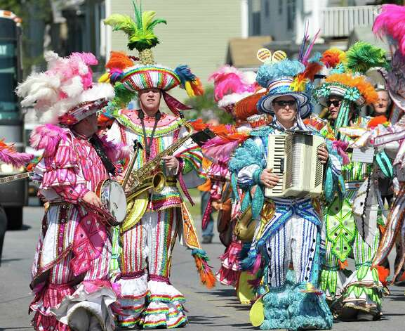 Members of the Greater Verbrook String Band from Upper Darby, PA, perform as they march along Fifth Ave. during the 40th Annual Uncle Sam Birthday Parade on Sunday, Sept. 13, 2015, in Lansingburgh, N.Y.  (Paul Buckowski / Times Union) Photo: PAUL BUCKOWSKI / 00033314A