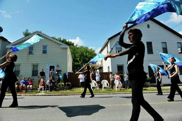 Members of the Excelsior Drum and Bugle Corps march down Fifth Ave.  during the 40th Annual Uncle Sam Birthday Parade on Sunday, Sept. 13, 2015, in Lansingburgh, N.Y.  (Paul Buckowski / Times Union) Photo: PAUL BUCKOWSKI / 00033314A