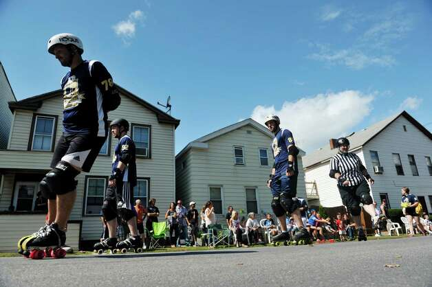 Members of the Capital District Trauma Authority roller derby team skate along Fifth Ave. during the 40th Annual Uncle Sam Birthday Parade on Sunday, Sept. 13, 2015, in Lansingburgh, N.Y.  (Paul Buckowski / Times Union) Photo: PAUL BUCKOWSKI / 00033314A