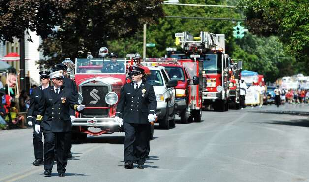 Members of the Speigletown Fire Department march along Fifth Ave. during the 40th Annual Uncle Sam Birthday Parade on Sunday, Sept. 13, 2015, in Lansingburgh, N.Y.  (Paul Buckowski / Times Union) Photo: PAUL BUCKOWSKI / 00033314A