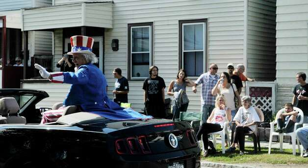 Fred Polnisch, dressed as Uncle Sam, waves to the crowd   during the 40th Annual Uncle Sam Birthday Parade on Sunday, Sept. 13, 2015, in Lansingburgh, N.Y.  (Paul Buckowski / Times Union) Photo: PAUL BUCKOWSKI / 00033314A