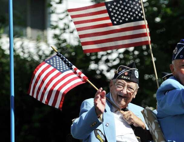 Korean War Army veteran, John Drescher of Troy waves to people along the parade route during the 40th Annual Uncle Sam Birthday Parade on Sunday, Sept. 13, 2015, in Lansingburgh, N.Y.  (Paul Buckowski / Times Union) Photo: PAUL BUCKOWSKI / 00033314A