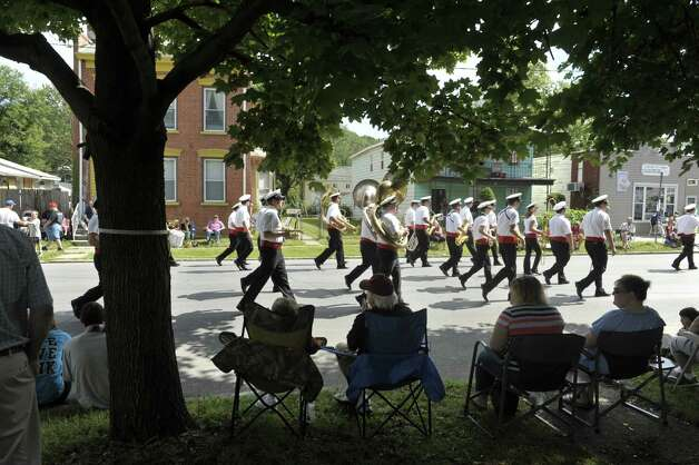 People watch from in the shade of a tree as a band marches by  during the 40th Annual Uncle Sam Birthday Parade on Sunday, Sept. 13, 2015, in Lansingburgh, N.Y.  (Paul Buckowski / Times Union) Photo: PAUL BUCKOWSKI / 00033314A