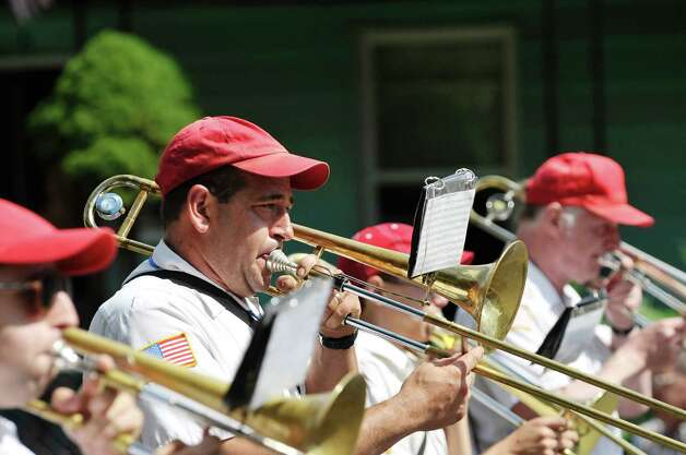 Members of The Red Caps marching band perform  during the 40th Annual Uncle Sam Birthday Parade on Sunday, Sept. 13, 2015, in Lansingburgh, N.Y.  (Paul Buckowski / Times Union) Photo: PAUL BUCKOWSKI / 00033314A
