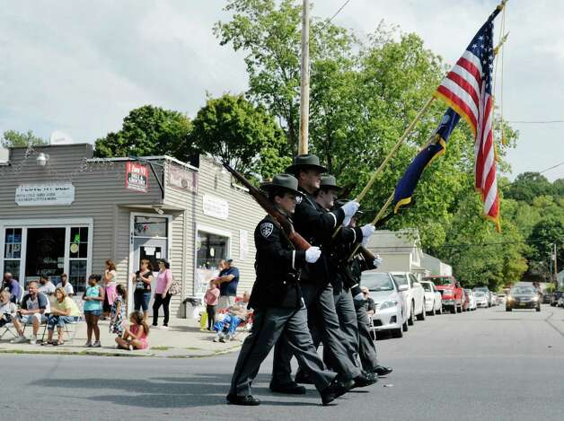 Members of the Rensselaer County Sheriff march along Fifth Ave. during the 40th Annual Uncle Sam Birthday Parade on Sunday, Sept. 13, 2015, in Lansingburgh, N.Y.  (Paul Buckowski / Times Union) Photo: PAUL BUCKOWSKI / 00033314A