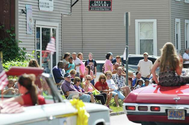 People line Fifth Ave. as they watch the 40th Annual Uncle Sam Birthday Parade on Sunday, Sept. 13, 2015, in Lansingburgh, N.Y.  (Paul Buckowski / Times Union) Photo: PAUL BUCKOWSKI / 00033314A