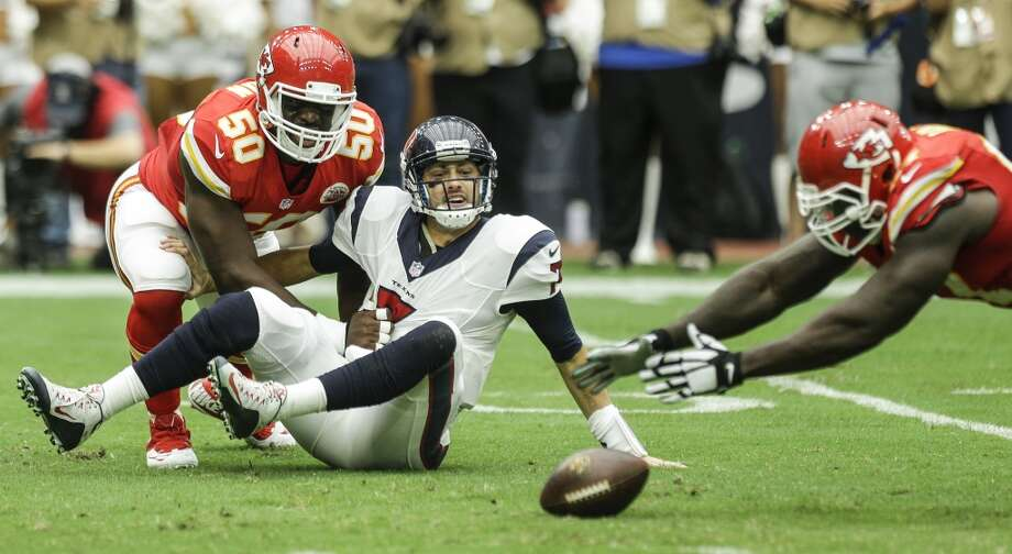 Kansas City Chiefs defensive end Allen Bailey (97) dives on a fumble by Houston Texans quarterback Brian Hoyer (7) after Hoyer was sacked by Chiefs outside linebacker Justin Houston (50) during the second quarter of an NFL football game at NRG Stadium on Sunday, Sept. 13, 2015, in Houston. ( Brett Coomer / Houston Chronicle ) Photo: Brett Coomer, Houston Chronicle