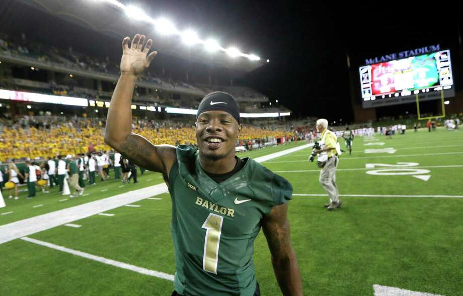 Corey Coleman enjoys becoming the first Baylor player with four TD catches in a game. Photo: LM Otero, STF / AP