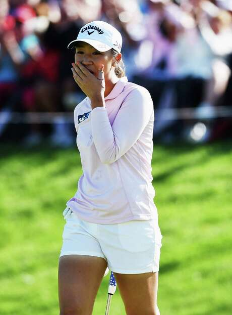 Lydia Ko is unable to keep her emotions in check after winning the Evian Championship for her first major title. Photo: Stuart Franklin, Staff / 2015 Getty Images