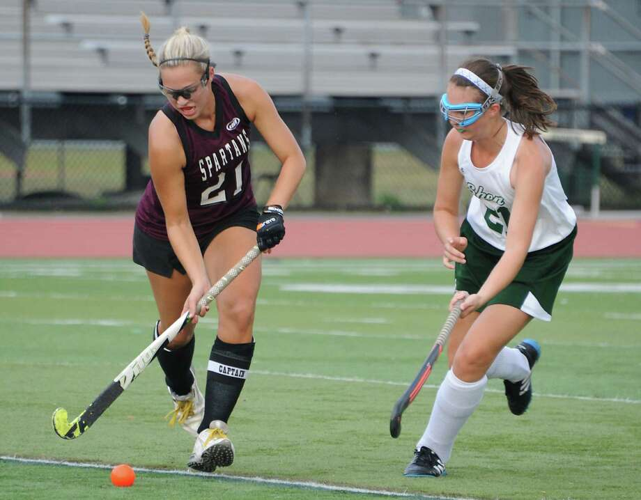 Burnt Hills' Lexie Ball, left, and Shenendehowa's Kelly Quinn battle for the ball during a field hockey game on Tuesday Sept. 8, 2015 in Clifton Park, N.Y. (Lori Van Buren / Times Union) Photo: Lori Van Buren / 00033257A