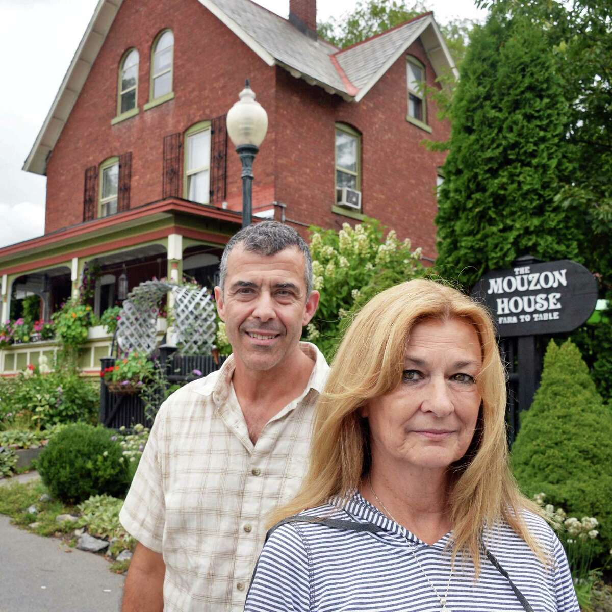 David and Dianne Pedinotti, husband and wife co-owners of the Mouzon House outside their restaurant Thursday Sept. 10, 2015 in Saratoga Springs, NY. They are in a legal battle to stop the proposed city center's high-rise garage from being built next to their restaurant. (John Carl D'Annibale / Times Union)