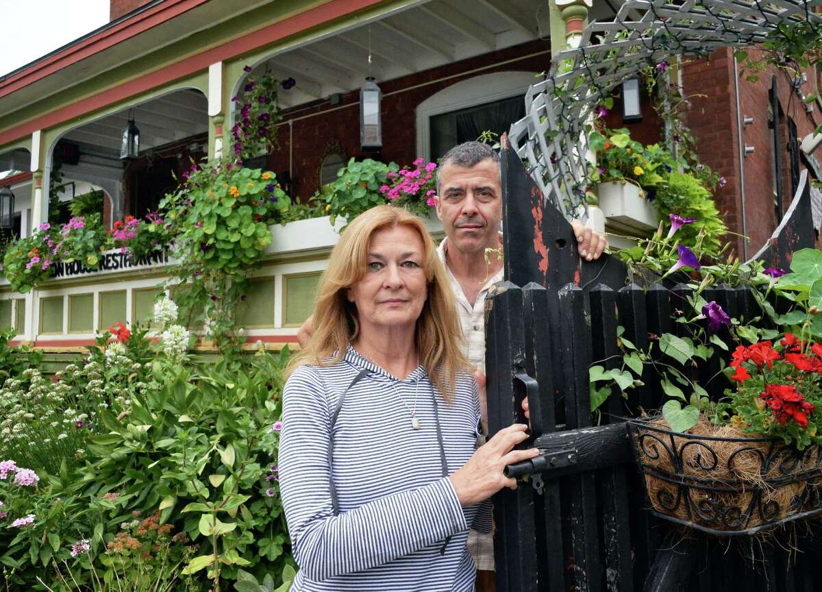Dianne and David Pedinotti, co-owners of the Mouzon House outside their restaurant Thursday Sept. 10, 2015 in Saratoga Springs, NY. They are in a legal battle to stop the proposed city center's high-rise garage from being built next to their restaurant. (John Carl D'Annibale / Times Union)