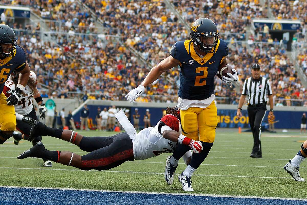 Cal running back Daniel Lasco scores a touchdown against San Diego State on Sept. 12 before his hip injury flared up.