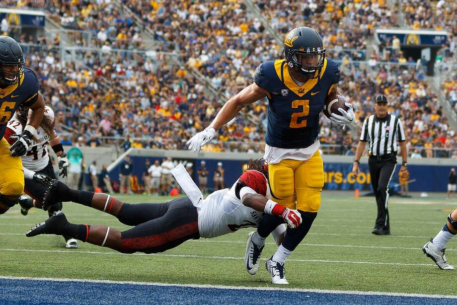 BERKELEY, CA - SEPTEMBER 12:  Running back Daniel Lasco #2 of the California Golden Bears scores a touchdown past defensive back Na'im McGee #21 of the San Diego State Aztecs during the third quarter at California Memorial Stadium on September 12, 2015 in Berkeley, California. The California Golden Bears defeated the San Diego State Aztecs 35-7. (Photo by Jason O. Watson/Getty Images) Photo: Jason O. Watson, Getty Images