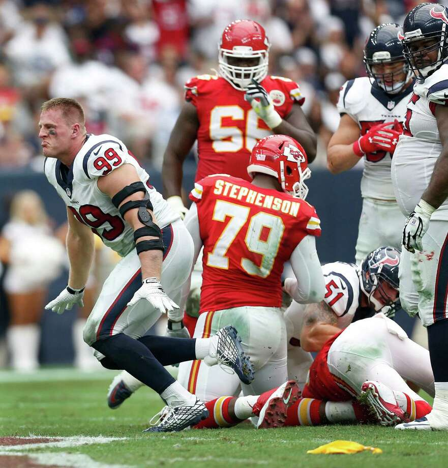 One of Texans defensive end J.J. Watt's two sacks Sunday against the Chiefs came sans helmet. Watt said he's made tackles without his helmet, but he can't recall a bareheaded sack. Photo: Karen Warren, Staff / © 2015 Houston Chronicle