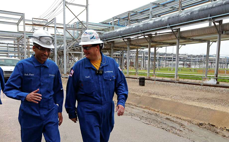 LyondellBasell CEO Bob Patel (left) and plant manager Todd Monette walk through the Channelview plant. Photo: James Nielsen /Houston Chronicle / © 2015  Houston Chronicle
