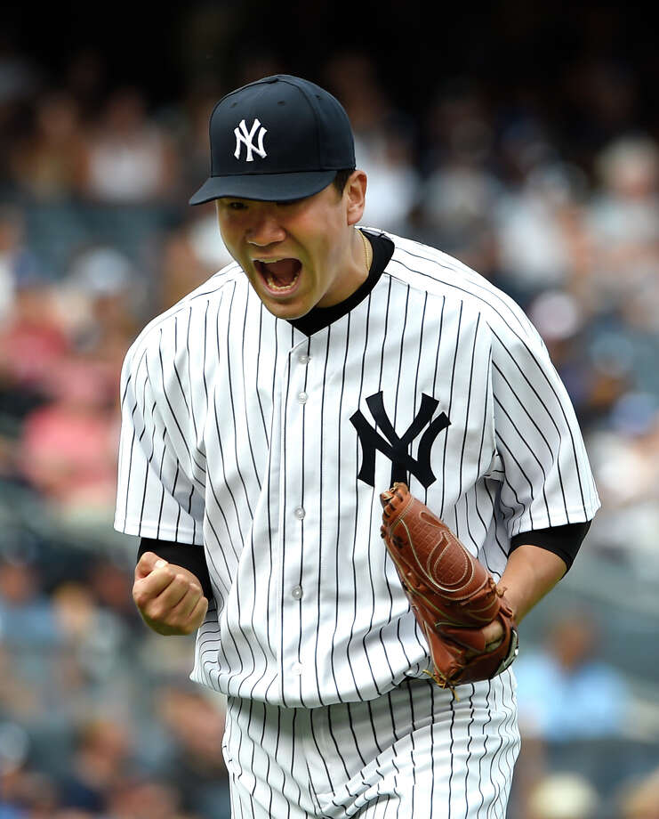 New York Yankees starting pitcher Masahiro Tanaka reacts after getting Toronto Blue Jays' Kevin Pillar to fly out for the third out in the seventh inning of a baseball game at Yankee Stadium, Sunday, Sept. 13, 2015, in New York. The Yankees won 5-0. (AP Photo/Kathy Kmonicek)  ORG XMIT: NYY117 Photo: Kathy Kmonicek / FR170189 AP