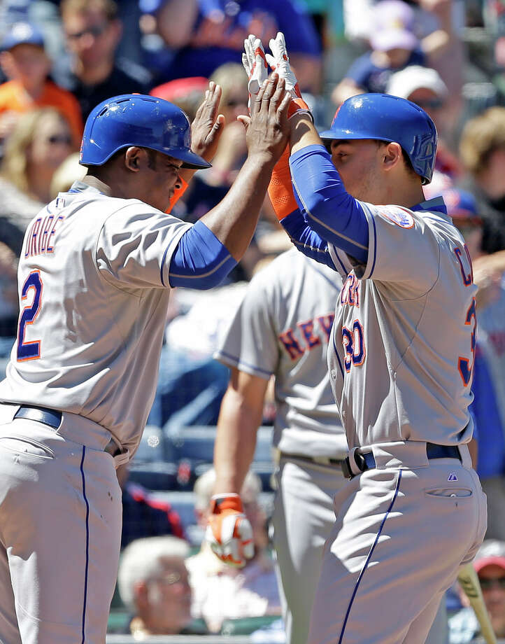New York Mets' Michael Conforto (30) celebrates with teammate Juan Uribe (2) after hitting a home run during the second inning of a baseball game against the Atlanta Braves, Sunday, Sept. 13, 2015, in Atlanta. (AP Photo/Butch Dill) ORG XMIT: GABD103 Photo: Butch Dill / FR111446 AP