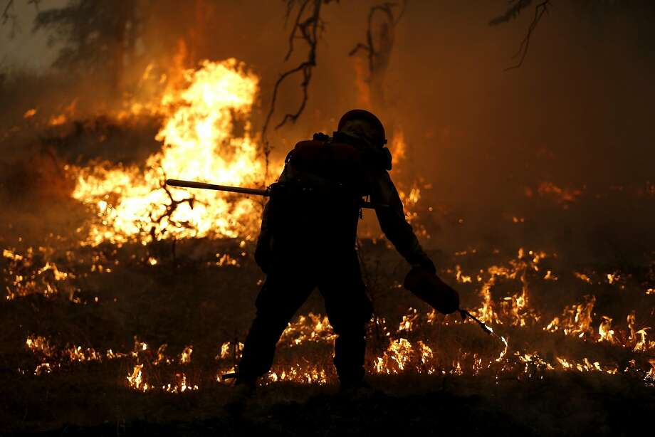 Firefighter Casey Rodd of Marin County Fire Department's Tamalpais Fire Crew burns a fire line near Middletown, California, on Sunday, Sept. 13, 2015. Photo: Connor Radnovich, The Chronicle