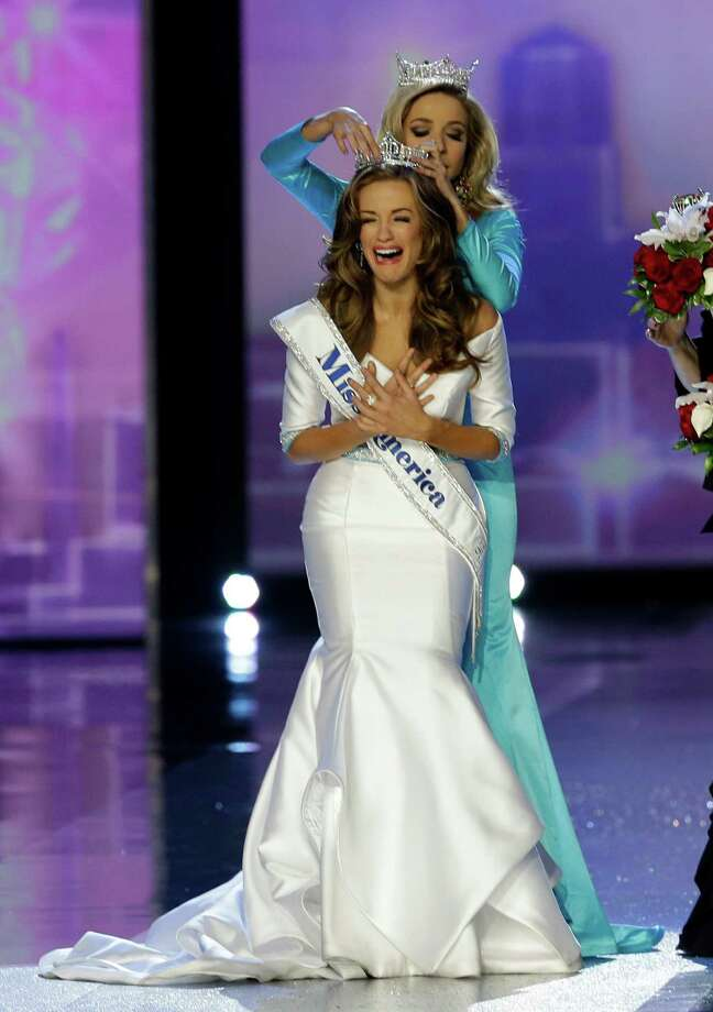 Miss Georgia, Betty Cantrell, is crowned Miss America 2016 by Miss America 2015, Kira Kazantsev. Photo: Mel Evans, STF / AP