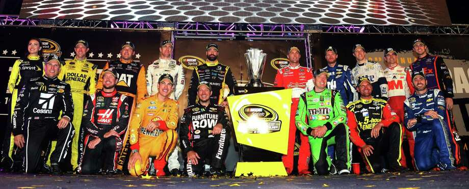 (Back row L-R) Matt Kenseth, driver of the #20 Dollar General Toyota, Ryan Newman, driver of the #31 Caterpillar Chevrolet, Carl Edwards, driver of the #19 ARRIS Toyota, Paul Menard, driver of the #27 Libman/Menards Chevrolet, Kevin Harvick, driver of the #4 Budweiser/Jimmy John's Chevrolet, Dale Earnhardt Jr., driver of the #88 Nationwide Chevrolet, Brad Keselowski, driver of the #2 Miller Lite Ford, Jeff Gordon, driver of the #24 3M Chevrolet, Denny Hamlin, driver of the #11 FedEx Express Toyota, (front row L-R) Jamie McMurray, driver of the #1 Cessna Chevrolet, Kurt Busch, driver of the #41 Haas Automation Chevrolet, Joey Logano, driver of the #22 Shell Pennzoil Ford, Martin Truex Jr., driver of the #78 Furniture Row/Visser Precision Chevrolet, Kyle Busch, driver of the #18 M&M's Crispy/American Heritage Chocolate Toyota, Clint Bowyer, driver of the #15 5-hour Energy Toyota, and Jimmie Johnson, driver of the #48 Lowe's Chevrolet,  pose for a photo after making the Chase for the Sprint Cup after the NASCAR Sprint Cup Series Federated Auto Parts 400 at Richmond International Raceway Saturday, Sept. 12, 2015 in Richmond, Virginia.  (Matt Sullivan/NASCAR via AP) ORG XMIT: NY151 Photo: Matt Sullivan / NASCAR