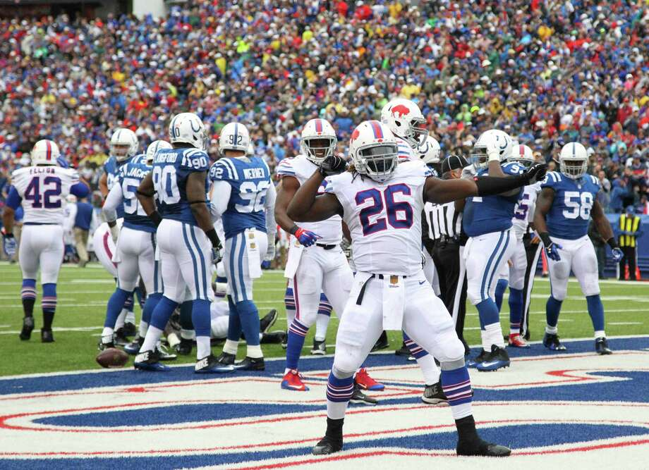 Buffalo Bills running back Boobie Dixon (26) celebrates his touchdown against the Indianapolis Colts during the second half of an NFL football game on Sunday, Sept. 13, 2015, in Orchard Park, N.Y. (AP Photo/Bill Wippert)  ORG XMIT: NYMG114 Photo: Bill Wippert / FR170745 AP