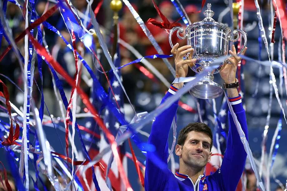Novak Djokovic of Serbia celebrates his third Grand Slam victory of the year, and 10th overall. Photo: Jewel Samad, AFP / Getty Images