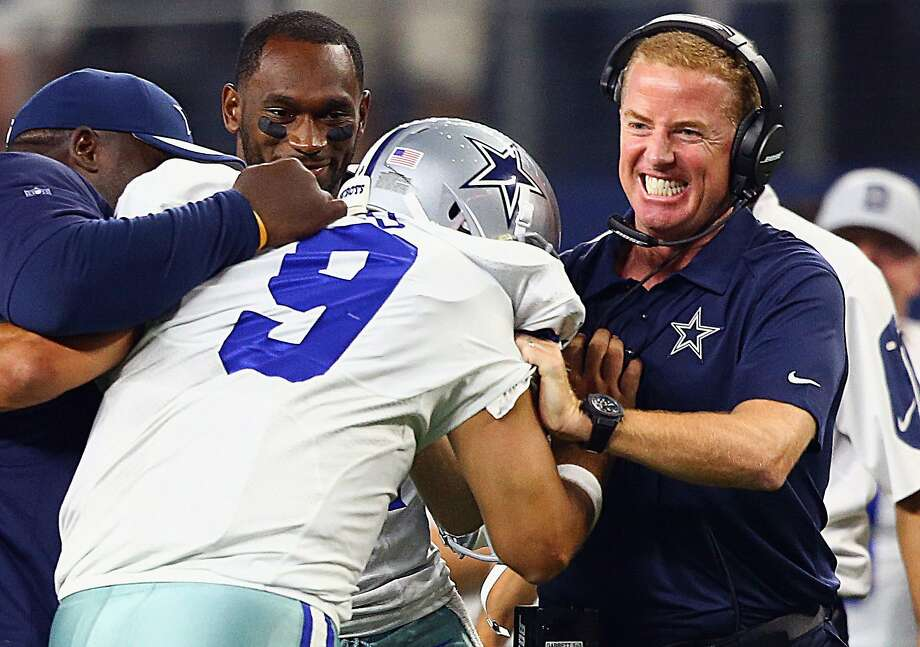 Tony Romo celebrates with coach Jason Garrett after the go-ahead TD with seven seconds left. Photo: Ronald Martinez, Getty Images