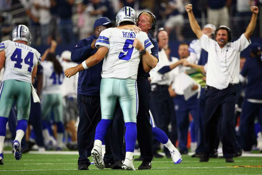ARLINGTON, TX - SEPTEMBER 13:  Tony Romo #9 celebrates the game winning touchdown with head coach Jason Garrett of the Dallas Cowboys in the fourth quarter against the New York Giants at AT&T Stadium on September 13, 2015 in Arlington, Texas.  (Photo by Ronald Martinez/Getty Images) ORG XMIT: 566357813 Photo: Ronald Martinez / 2015 Getty Images