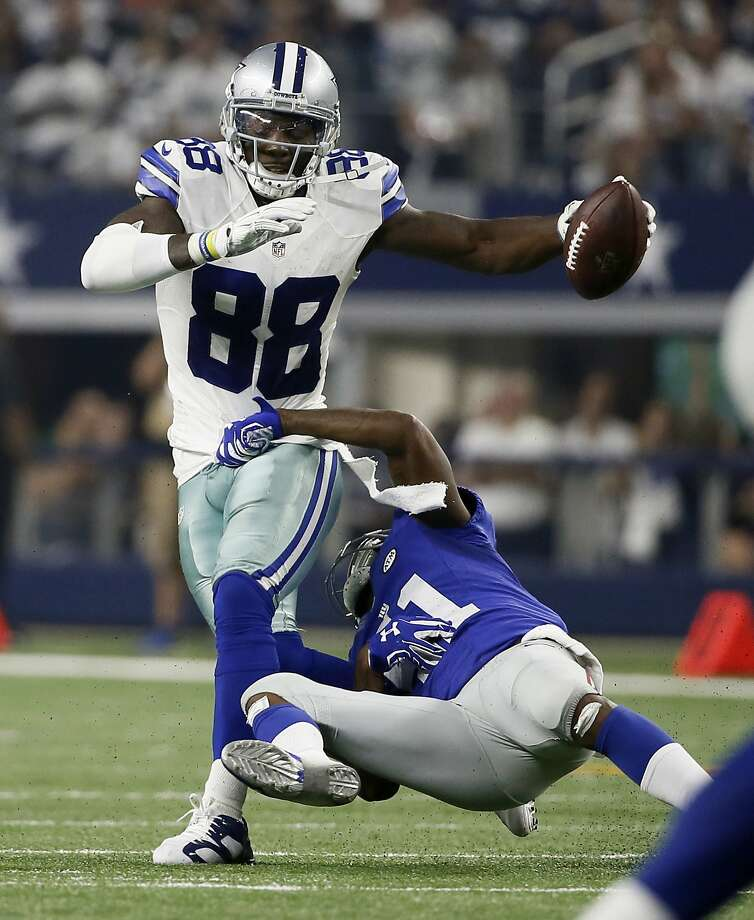 Dez Bryant (88) is tackled by New York Giants cornerback Dominique Rodgers-Cromartie earlier this season. Photo: Tony Gutierrez, Associated Press