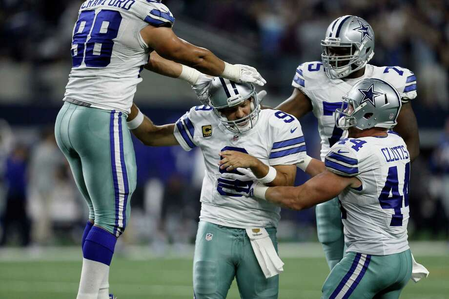Dallas Cowboys quarterback Tony Romo (9), defensive tackle Tyrone Crawford (98), tackle Darrion Weems (75) and fullback Tyler Clutts (44)  celebrate a last minute touchdown pass to tight end Jason Witten (82) to win against the New York Giants during the second half of an NFL football game Sunday, Sept. 13, 2015, in Arlington, Texas. Cowboys won 27-26. (AP Photo/Brandon Wade) Photo: Brandon Wade, =213019000118t= / Associated Press / =213019000118n=