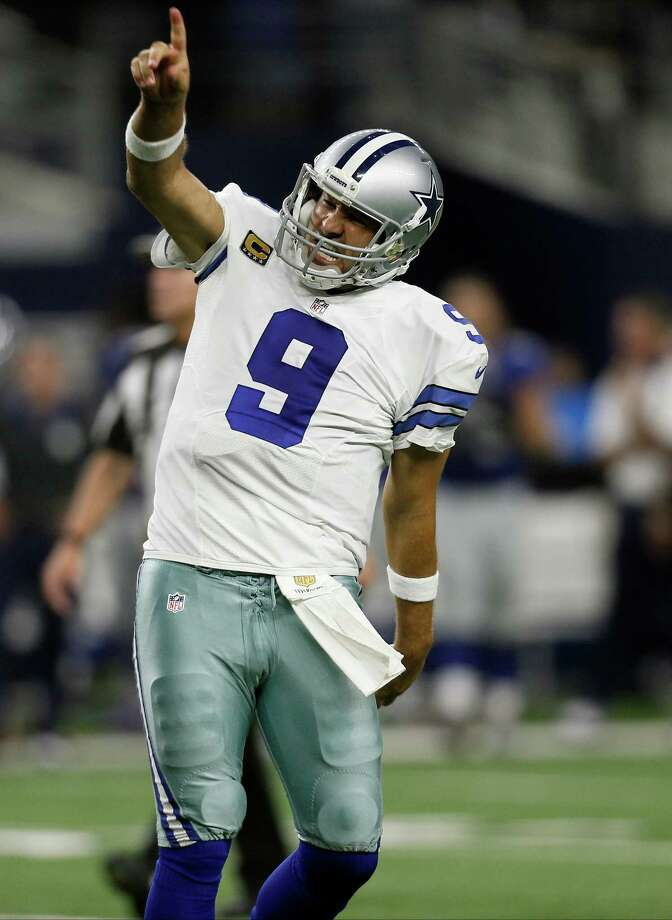 Dallas Cowboys quarterback Tony Romo (9) celebrates a last minute touchdown pass to tight end Jason Witten (82) to win against the New York Giants during the second half of an NFL football game Sunday, Sept. 13, 2015, in Arlington, Texas. Cowboys won 27-26. (AP Photo/Brandon Wade) Photo: Brandon Wade, =213019000118t= / Associated Press / =213019000118n=