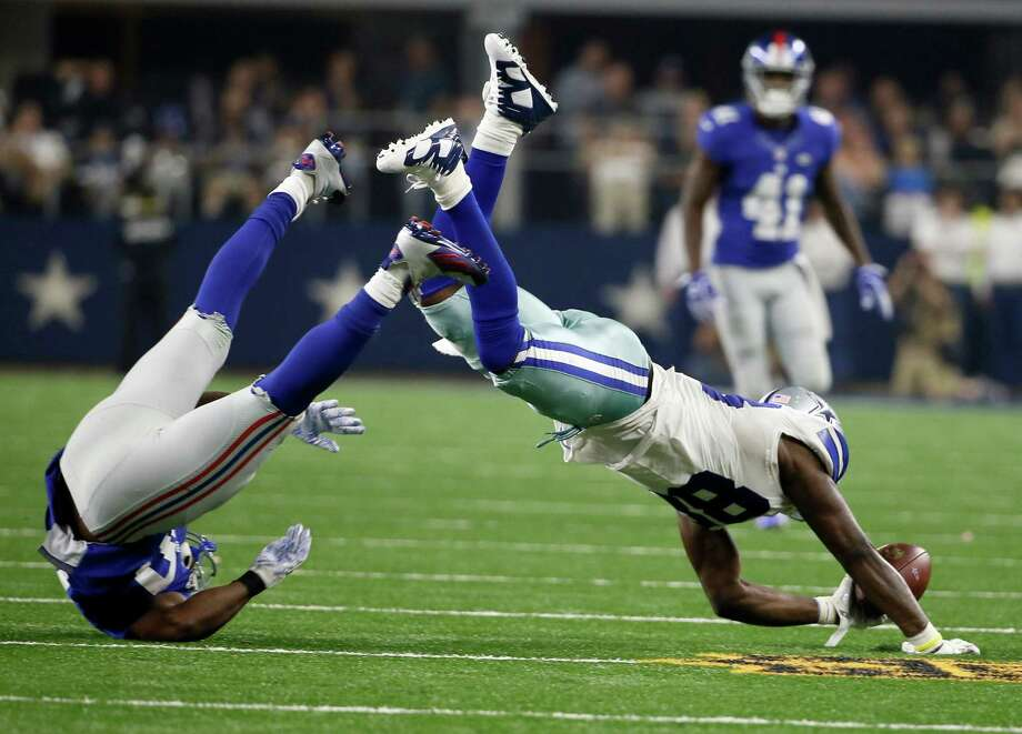 Dallas Cowboys wide receiver Dez Bryant (88) topples over New York Giants cornerback Prince Amukamara (20) during the second half of an NFL football game Sunday, Sept. 13, 2015, in Arlington, Texas. (AP Photo/Tony Gutierrez) Photo: Tony Gutierrez, STF / AP