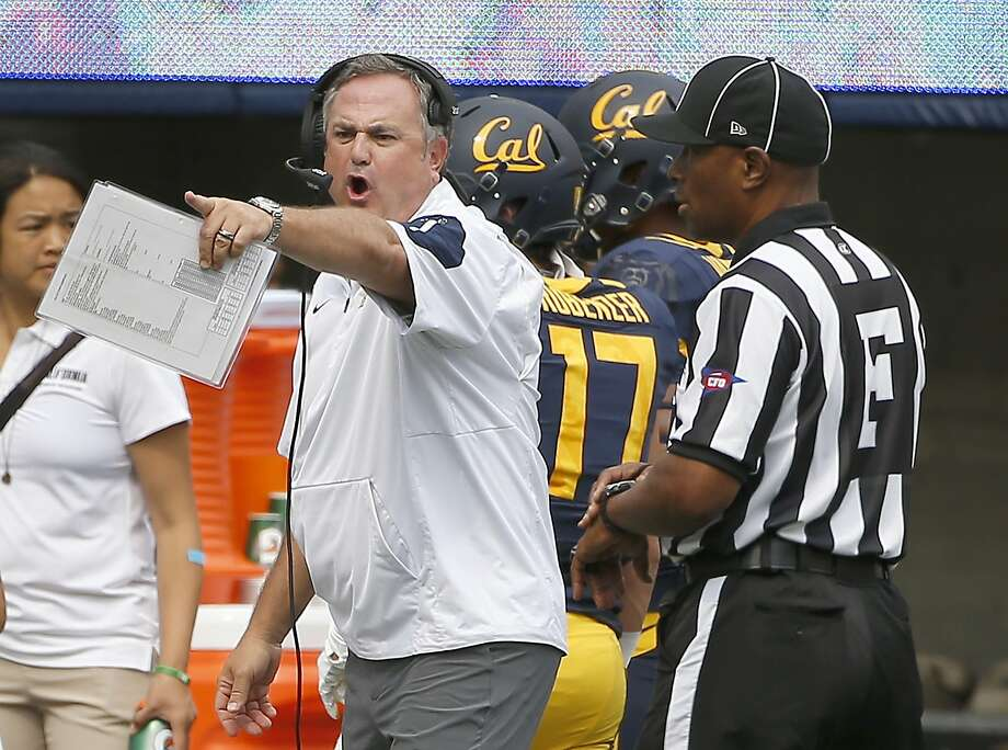 California head coach Sonny Dykes, center, argues a call with the referee during the first half against San Diego State of an NCAA college football game Saturday, Sept. 12, 2015, in Berkeley, Calif. (AP Photo/Tony Avelar) Photo: Tony Avelar, Associated Press