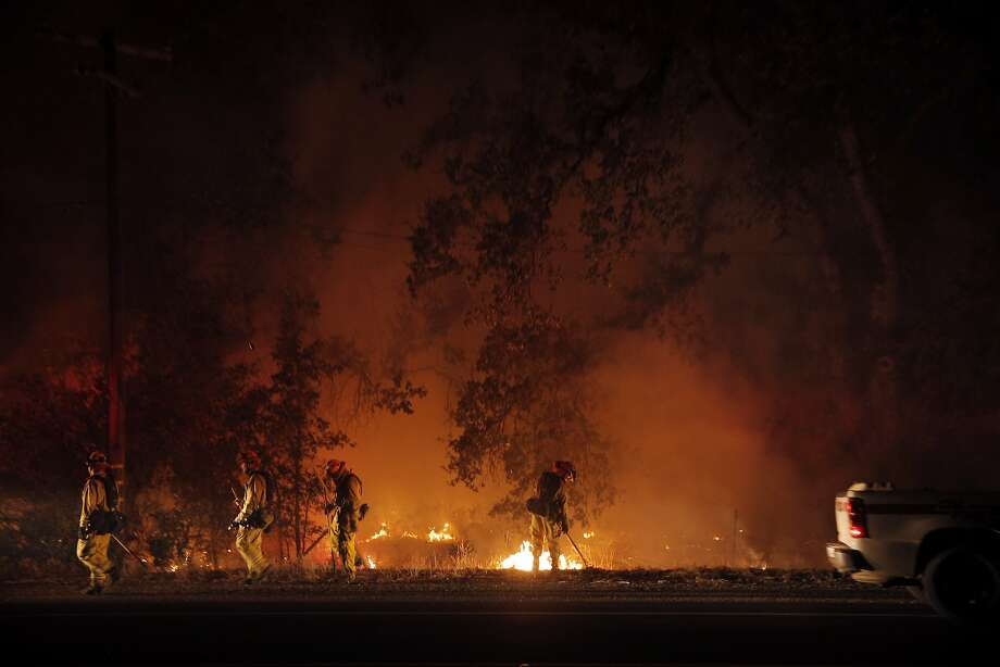 A CalFire crew from Santal Clara County keeps tabs on a back fire along highway 29 in Middletown, Calif., on Sunday, September 13, 2015, the day after a wildfire swept through town destroying homes and forcing mass evacuations. Photo: Carlos Avila Gonzalez, The Chronicle