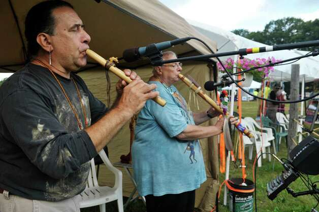 Eric Marczak, left, from Knox, and a Mohawk by marriage, and Richard Soaring Owl from Burlington, MA play flutes at the 6th Annual Gathering of the Tribes at Browns Farm on Sunday, Sept. 13, 2015, in East Greenbush, N.Y.  (Paul Buckowski / Times Union) Photo: PAUL BUCKOWSKI / 00033193A