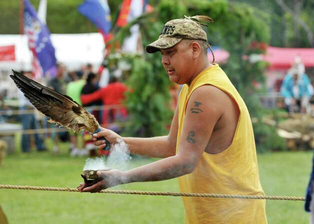 Mitchell Waukau, from Chestertown and a member of the Menominee Tribe, performs smudging to purify the area before the grand entrance at the 6th Annual Gathering of the Tribes at Browns Farm on Sunday, Sept. 13, 2015, in East Greenbush, N.Y.  (Paul Buckowski / Times Union) Photo: PAUL BUCKOWSKI / 00033193A