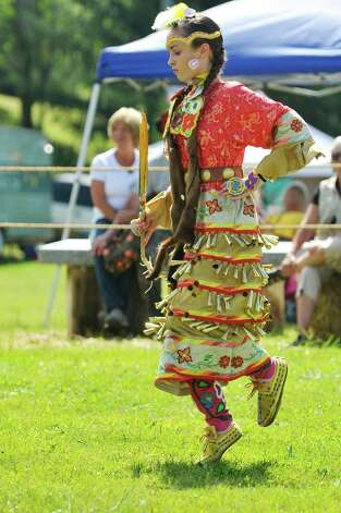 Anisha Pasaghesic from Glens Falls and a member of the Ojibwe and Abenaki Tribes dances the jingle dress dance at the 6th Annual Gathering of the Tribes at Browns Farm on Sunday, Sept. 13, 2015, in East Greenbush, N.Y.  (Paul Buckowski / Times Union) Photo: PAUL BUCKOWSKI / 00033193A