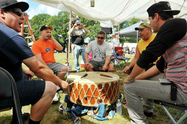 Members of the RezDogs perform on the sacred drum at the 6th Annual Gathering of the Tribes at Browns Farm on Sunday, Sept. 13, 2015, in East Greenbush, N.Y.  (Paul Buckowski / Times Union) Photo: PAUL BUCKOWSKI / 00033193A