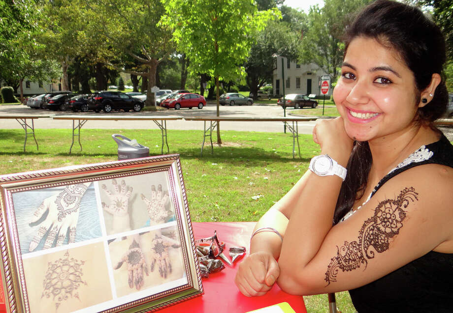 Harmeet Kaur offered temporary Henna tattoos at the 9th annual Heritage India Fest at on Town Hall Green. Photo: Mike Lauterborn / For Hearst Connecticut Media / Fairfield Citizen