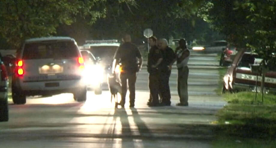 Police were searching the area around Darien and Glen Manor in Houston, Sunday night, Sept. 13, 2015 after a son reportedly pistol whipped his father. Photo: Metro Video