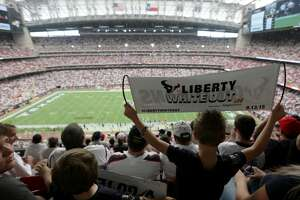 """Cohen Brunner, 6, holds up a """"Liberty White Out sign"""" during the first half of an NFL game between the Houston Texans and the Kansas City Chiefs, at NRG Stadium, Sunday, Sept. 13, 2015, in Houston.  ( Jon Shapley / Houston Chronicle )"""
