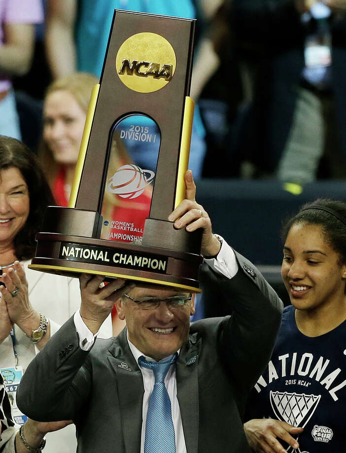Connecticut head coach Geno Auriemma holds the national championship trophy after the second half of the NCAA women's Final Four tournament college basketball championship game against Notre Dame, Tuesday, April 7, 2015, in Tampa, Fla. Connecticut won 63-53. (AP Photo/Chris O'Meara) Photo: Chris O'Meara / Associated Press / AP