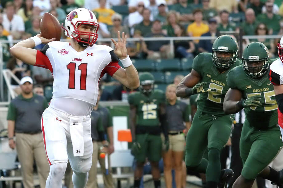 Carson Earp, 11, passes the ball during the game between the Lamar Cardinals and Baylor Bears at McLane Stadium in Waco Saturday night, September 12th, 2015 - photo provided by Kyle Ezell