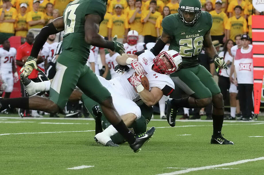 Kade Harrington, 8, is brought down by the Bear defense during the game between the Lamar Cardinals and Baylor Bears at McLane Stadium in Waco Saturday night, September 12th, 2015 - photo provided by Kyle Ezell