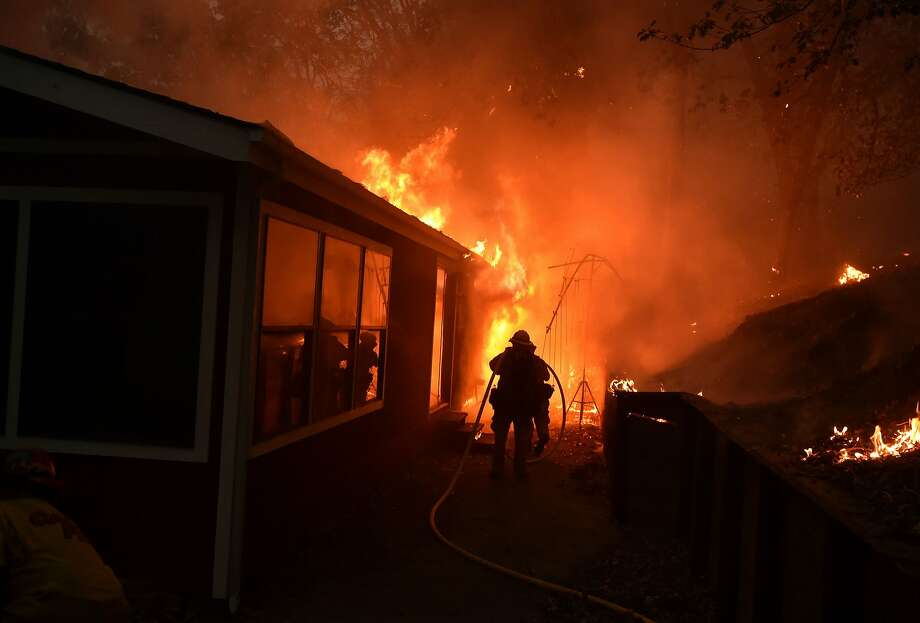 A house is engulfed in flames during the Valley Fire in Seigler Springs, California on September 13, 2015. Photo: Josh Edelson, AFP / Getty Images
